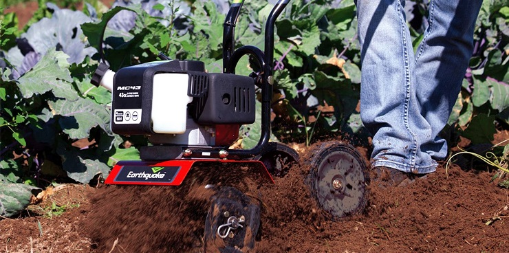 Man using earthquake MC43 mini cultivator