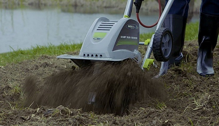 Man using earthwise cultivator