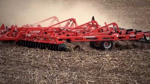 Big red tiller used on land.